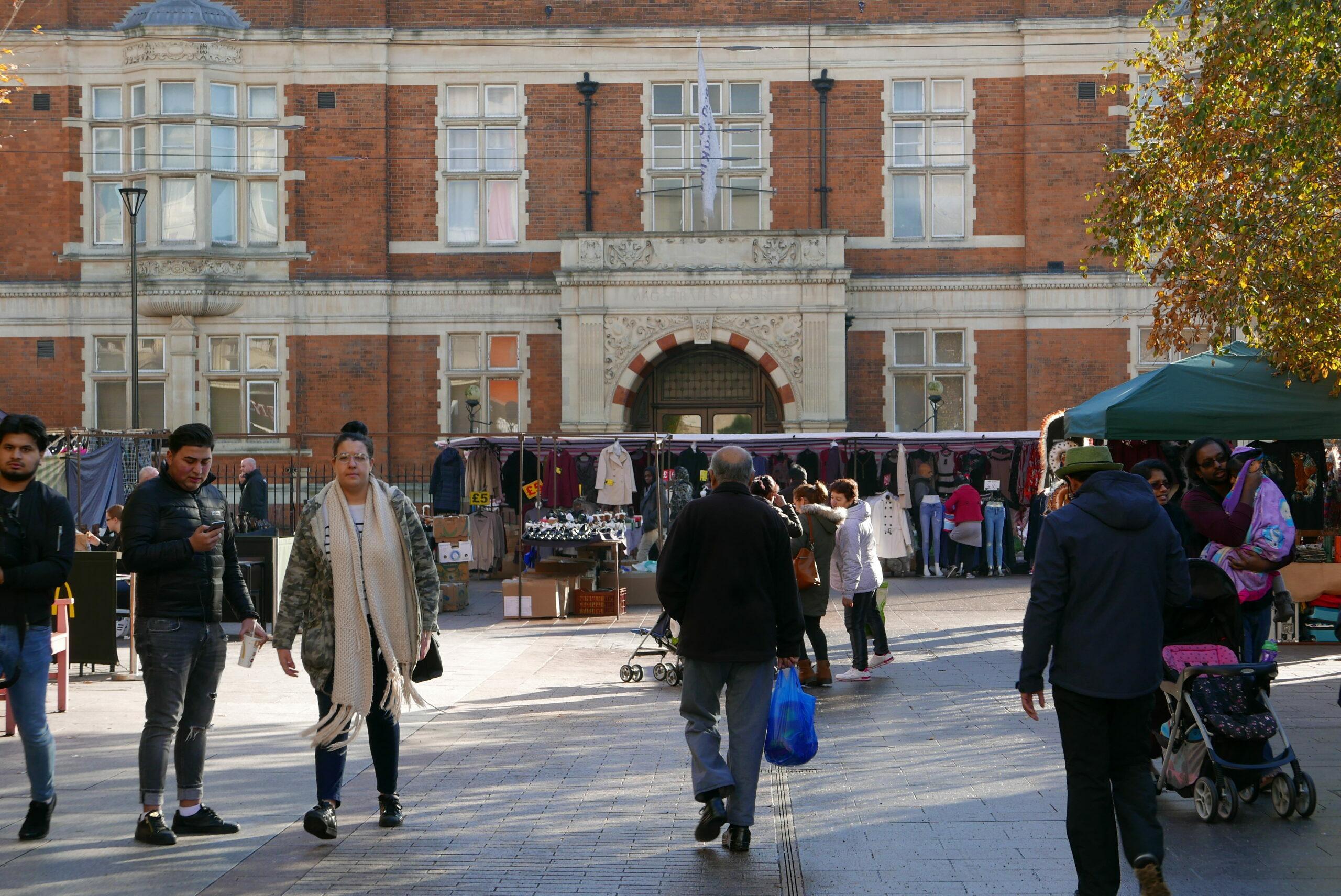 People walking through Barking market